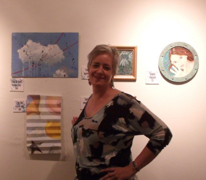 artist, Macarena Zilveti with 2 of her paintings in the Clouds and Oceans exhibit at Ave. 74